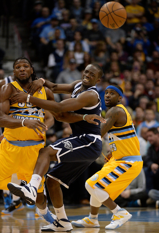 . Denver Nuggets power forward Kenneth Faried (35) knocks the ball away from Oklahoma City Thunder point guard Reggie Jackson (15) as Denver Nuggets point guard Ty Lawson (3) looks on during the first quarter January 9, 2014 at Pepsi Center. (Photo by John Leyba/The Denver Post)