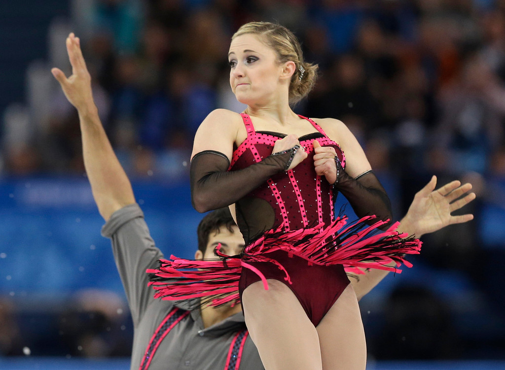 Description of . Paige Lawrence and Rudi Swiegers of Canada compete in the pairs short program figure skating competition at the Iceberg Skating Palace during the 2014 Winter Olympics, Tuesday, Feb. 11, 2014, in Sochi, Russia. (AP Photo/Darron Cummings)