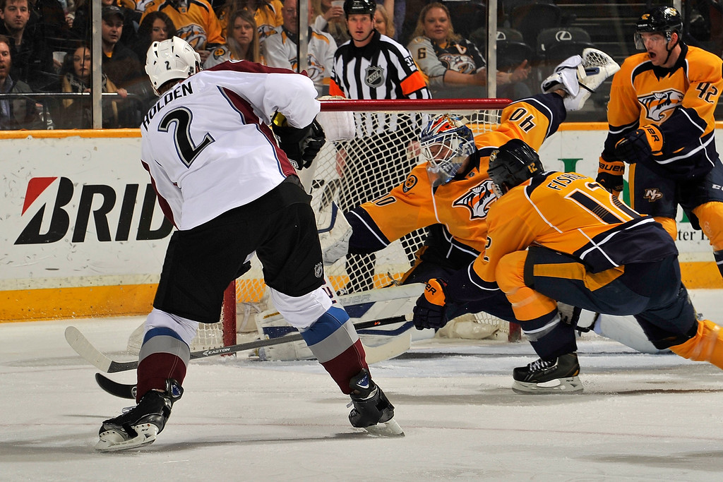 . NASHVILLE, TN - JANUARY 18: Nick Holden #2 of the Colorado Avalanche scores a goal against goalie Devan Dubnyk #40 of the Nashville Predators at Bridgestone Arena on January 18, 2014 in Nashville, Tennessee.  (Photo by Frederick Breedon/Getty Images)