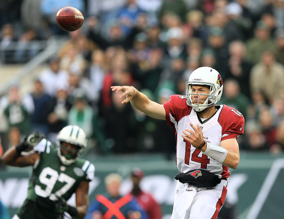 . Ryan Lindley #14 of the Arizona Cardinals passes the ball as Calvin Pace #97 of the New York Jets defends on December 2, 2012 at MetLife Stadium in East Rutherford, New Jersey. The New York Jets defeated the Arizona Cardinals 7-6.(Photo by Elsa/Getty Images)