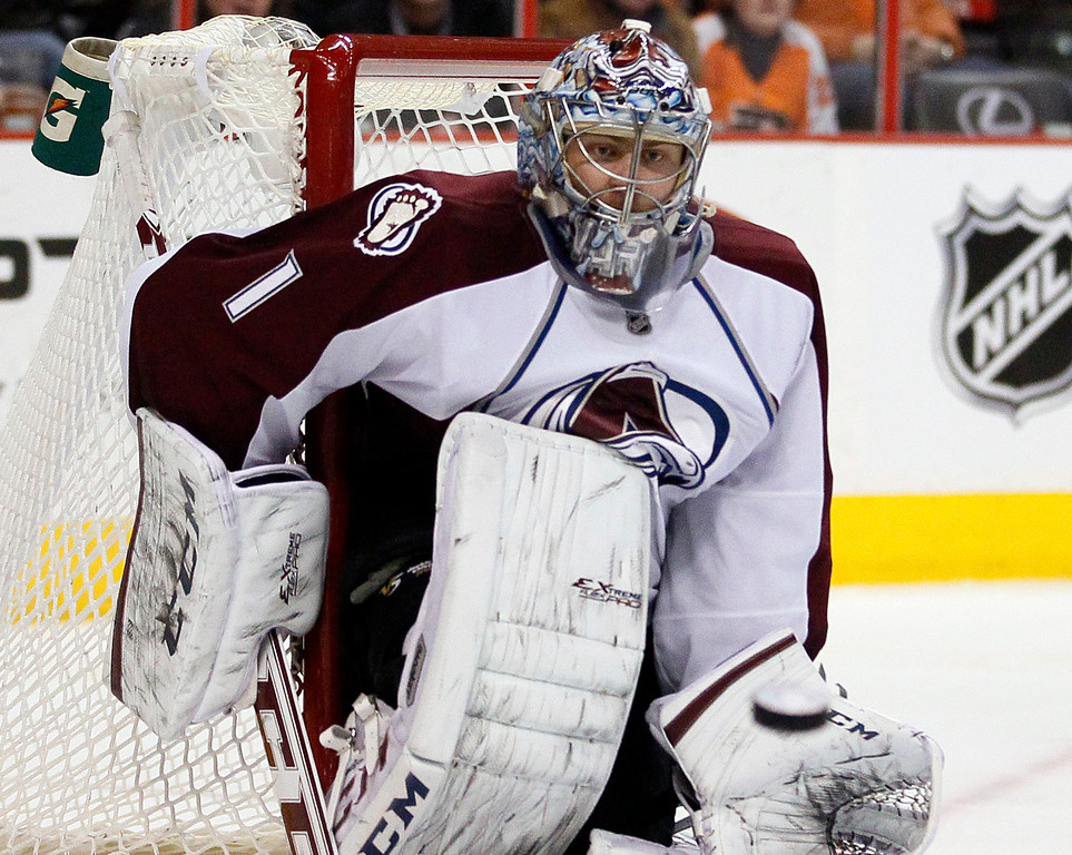 . Colorado Avalanche goalie Semyon Varlamov watches the puck heading to his glove by a shot from Philadelphia Flyers\' Brayden Schenn during the second period of an NHL hockey game, Thursday, Feb. 6, 2014, in Philadelphia. (AP Photo/Tom Mihalek)