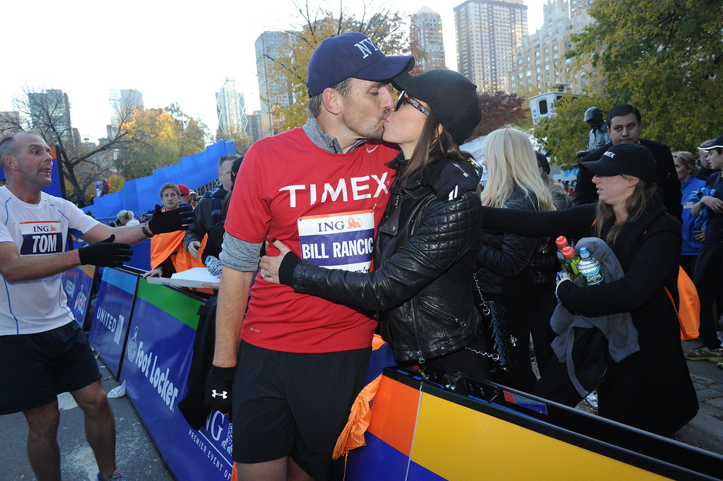 . Entrepreneur and TV personality Bill Rancic embraces his wife, Giuliana Rancic, after finishing the ING New York City Marathon on Sunday, November 3, 2013, in New York\'s Central Park. Rancic, who was the very last person to start the race, finished with an unofficial time of 4:57. Timex will be donating $30,000 to Fab-U-Wish, a charity founded by his wife Giuliana Rancic that supports women affected by breast and ovarian cancer. (Photo by Diane Bondareff/Invision for Timex/AP Images)