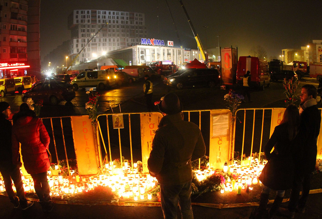 . People leave candles at the scene where the Maxima supermarket roof collapsed in Riga on November 23, 2013.    AFP PHOTO / PETRAS MALUKAS/AFP/Getty Images