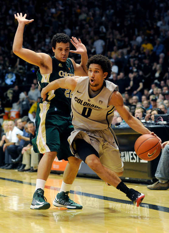 . Buffs point guard Askia Booker (0) got past Rams defender Dorian Green (22) in the second half. The University of Colorado men\'s basketball team defeated Colorado State University 70-61 at the Coors Events Center Wednesday night, November 5, 2012. Karl Gehring/The Denver Post