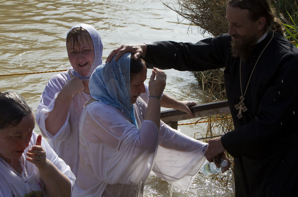 . Christian Orthodox pilgrims are blessed after immersing themselves into the waters of the Jordan River during a baptism ceremony marking the epiphany on January 18, 2014 at the Qasr al-Yahud baptismal site in the West Bank. For Christians, the Epiphany celebrates the baptism of Christ by John the Baptist in the river Jordan. AHMAD GHARABLI/AFP/Getty Images