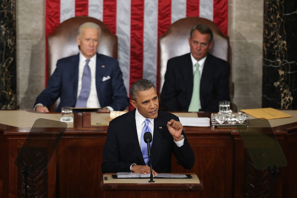 . WASHINGTON, DC - JANUARY 28:  U.S. President Barack Obama delivers the State of the Union address to a joint session of Congress in the House Chamber at the U.S. Capitol on January 28, 2014 in Washington, DC. In his fifth State of the Union address, Obama is expected to emphasize on healthcare, economic fairness and new initiatives designed to stimulate the U.S. economy with bipartisan cooperation.  (Photo by Alex Wong/Getty Images)