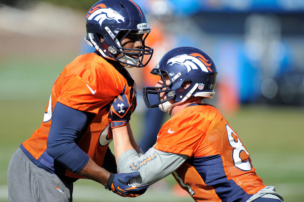 . Denver Broncos tight end Virgil Green (85) and Denver Broncos tight end Joel Dreessen (81) get in blocking drills during practice October 24, 2013 at Dove Valley. (Photo by John Leyba/The Denver Post)
