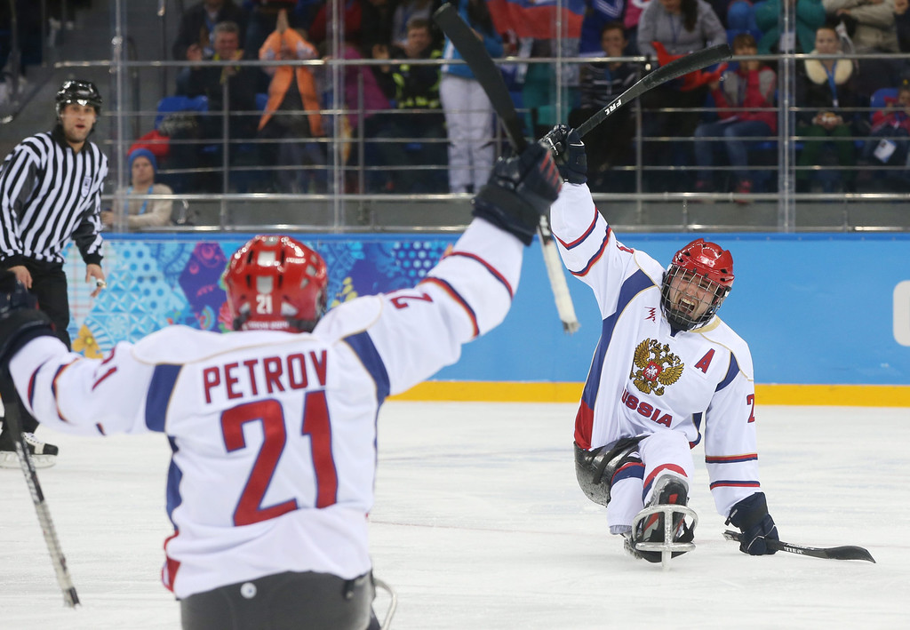 . Russian team players Evgeny Petrov (L) and Ilia Volkov (R) celebrate scoring against the USA during  their group stage  Ice Sledge Hockey match at Sochi 2014 Paralympic Games, Russia, 08 March 2014.  EPA/SERGEI CHIRIKOV