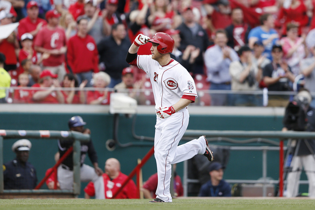 . CINCINNATI, OH - MAY 9:  Todd Frazier #21 of the Cincinnati Reds tips his cap as he rounds the bases after hitting a home run in the bottom of the second inning of the game against the Colorado Rockies at Great American Ball Park on May 9, 2014 in Cincinnati, Ohio. (Photo by Joe Robbins/Getty Images)