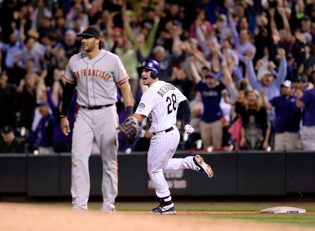 . Colorado batter Nolan Arenado (28) doubled to drive in two runs in the bottom of the ninth inning.  (Photo by Karl Gehring/The Denver Post)