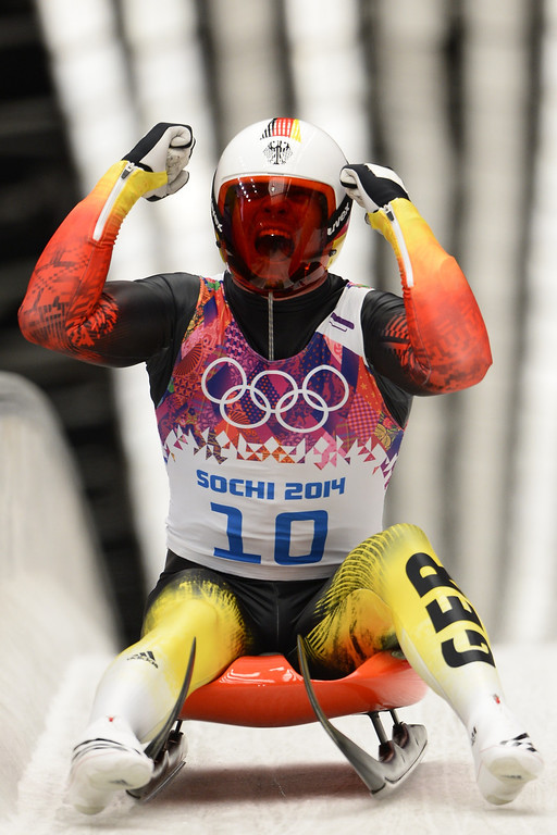 . Germany\'s Felix Loch celebrates his Gold Medal in the Men\'s Luge final at the Sanki Sliding Center during the Sochi Winter Olympics on February 9, 2014.                 LIONEL BONAVENTURE/AFP/Getty Images