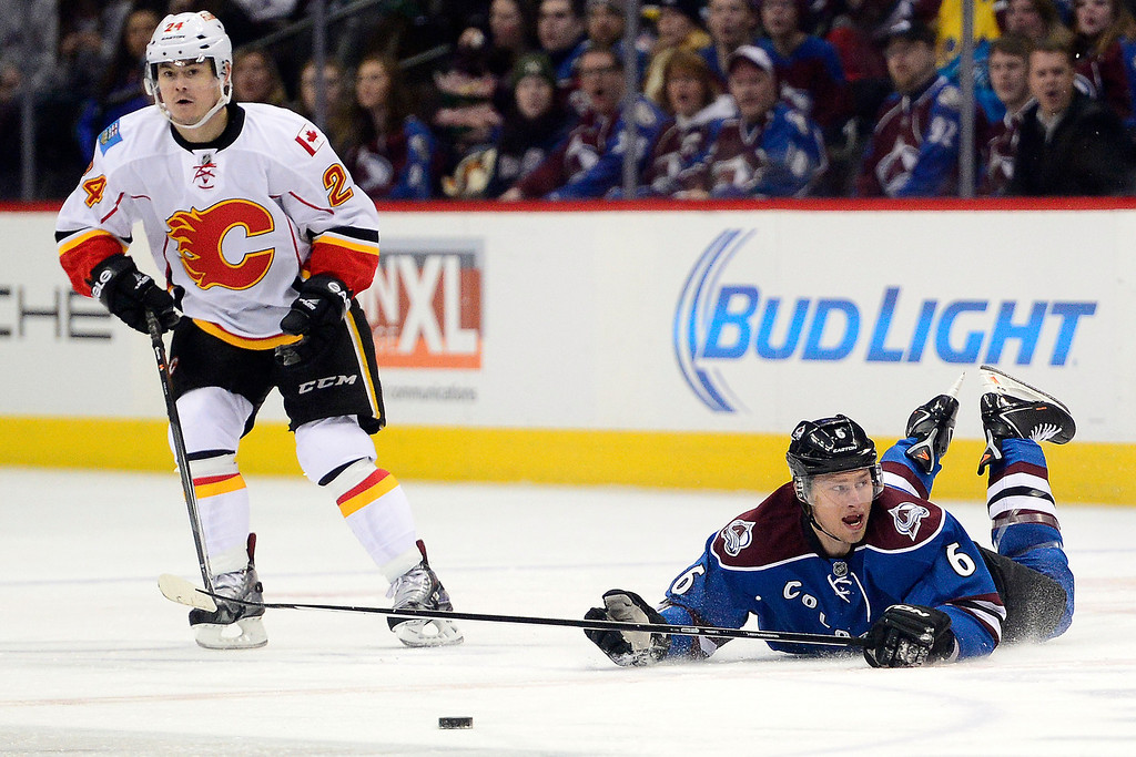 . Erik Johnson (6) of the Colorado Avalanche looks for a call after being tripped by Mike Cammalleri (13) of the Calgary Flames as Jiri Hudler (24) skates nearby during the first period.   (Photo by AAron Ontiveroz/The Denver Post)