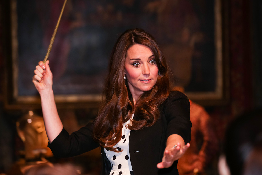 . Catherine, Duchess of Cambridge waves her wand on the set used to depict Diagon Alley in the Harry Potter Films during the Inauguration Of Warner Bros. Studios Leavesden on April 26, 2013 in London, England.