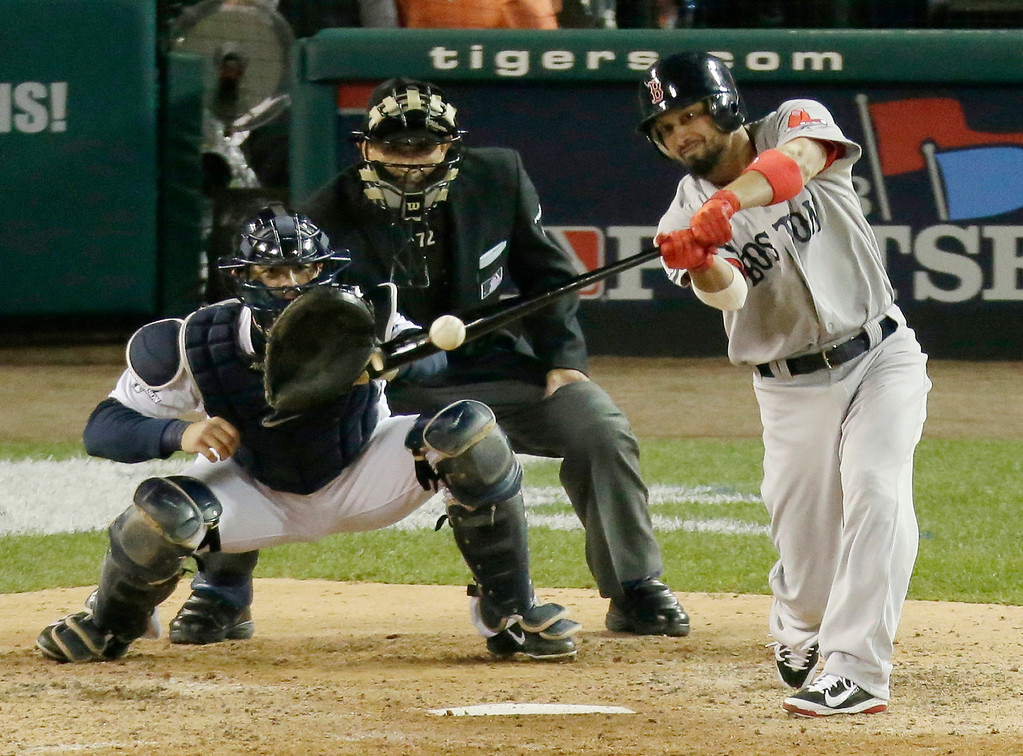 . Boston Red Sox\'s Shane Victorino hits an RBI double in the seventh inning during Game 4 of the American League baseball championship series against the Detroit Tigers, Wednesday, Oct. 16, 2013, in Detroit. (AP Photo/Charlie Riedel)