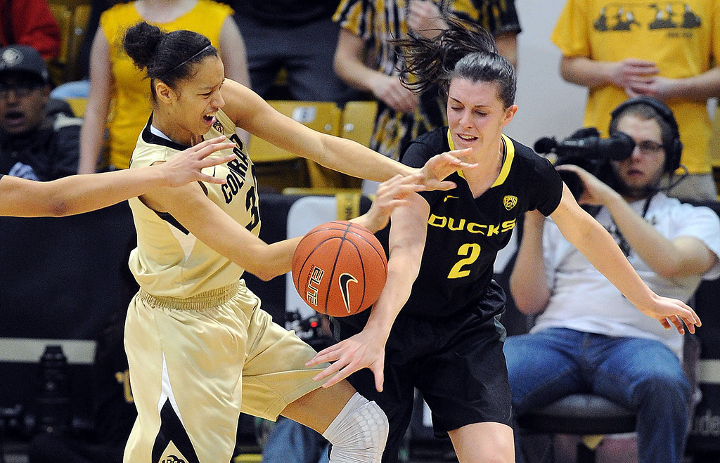 . Arielle Roberson of CU and Danielle Love of Oregon battle for a rebound. Cliff Grassmick / February 10, 2013