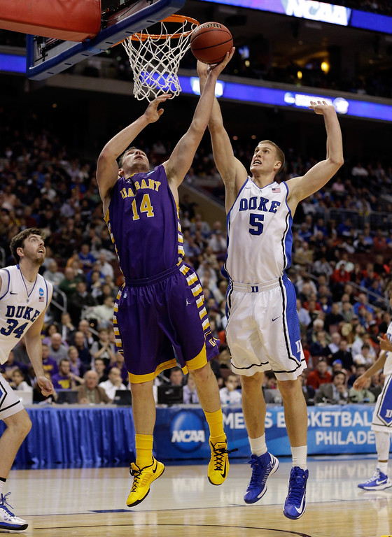 . Sam Rowley #14 of the Albany Great Danes with the ball under the basket against Mason Plumlee #5 of the Duke Blue Devils in the second half during the second round of the 2013 NCAA Men\'s Basketball Tournament on March 22, 2013 at Wells Fargo Center in Philadelphia, Pennsylvania.  (Photo by Rob Carr/Getty Images)