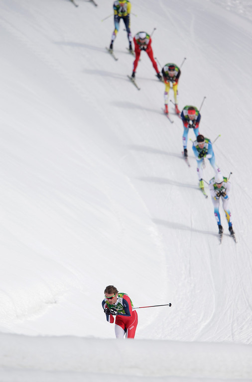 . Norway\'s Petter Northug is followed by his competitors during the men\'s final at the cross-country team sprint competitions at the 2014 Winter Olympics, Wednesday, Feb. 19, 2014, in Krasnaya Polyana, Russia. (AP Photo/Matthias Schrader)