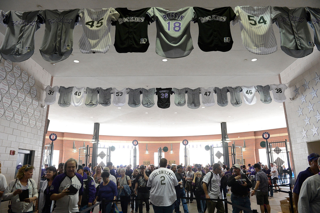 . Rockies jerseys line the walkway from the gates of Coors Field. (Photo by Andy Cross/The Denver Post)