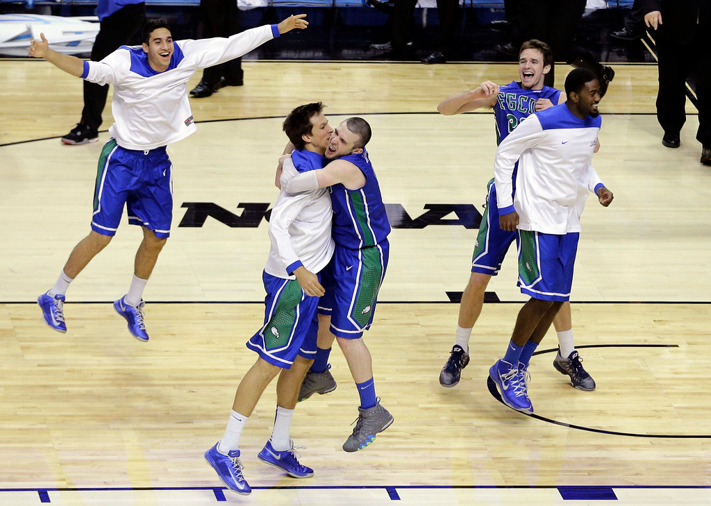 . Florida Gulf Coast players celebrate after winning a second-round game against Georgetown 78-68 in the NCAA college basketball tournament on Friday, March 22, 2013, in Philadelphia. (AP Photo/Matt Slocum)