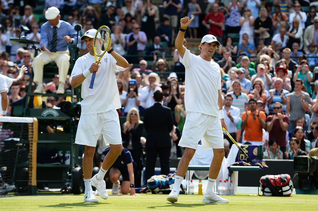 . LONDON, ENGLAND - JULY 04:  Bob Bryan and Mike Bryan of the United States of America salute the crowd as they celebrate victory during the Gentlemen�s Doubles semi final match against Rohan Bopanna of India and Edouard Roger-Vasselin of France on day ten of the Wimbledon Lawn Tennis Championships at the All England Lawn Tennis and Croquet Club on July 4, 2013 in London, England.  (Photo by Mike Hewitt/Getty Images)