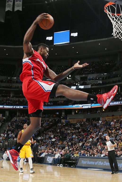. Los Angeles Clippers center DeAndre Jordan pulls down rebound against the Denver Nuggets in the fourth quarter of the Nuggets\' 116-115 victory in an NBA basketball game in Denver, Monday, Feb. 3, 2014. (AP Photo/David Zalubowski)