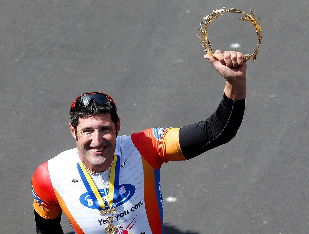 . Ernst van Dyke celebrates after he won the men\'s wheelchair division of the 2014 B.A.A. Boston Marathon on April 21, 2014 in Boston, Massachusetts.  (Photo by Jim Rogash/Getty Images)