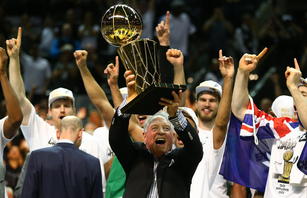 . San Antonio Spurs owner Peter Holt celebrates with the Larry O\'Brien trophy after defeating the Miami Heat to win the 2014 NBA Finals at the AT&T Center on June 15, 2014 in San Antonio, Texas.   (Photo by Andy Lyons/Getty Images)