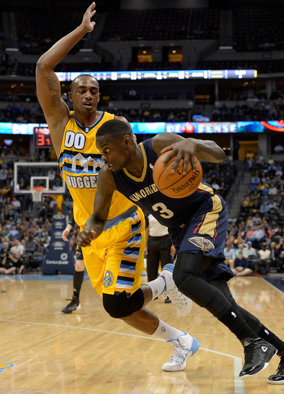. New Orleans Pelicans guard Anthony Morrow (3) drives on Denver Nuggets forward Darrell Arthur (00) during the first quarter April 2, 2014 at the Pepsi Center in Denver. (Photo by John Leyba/The Denver Post)