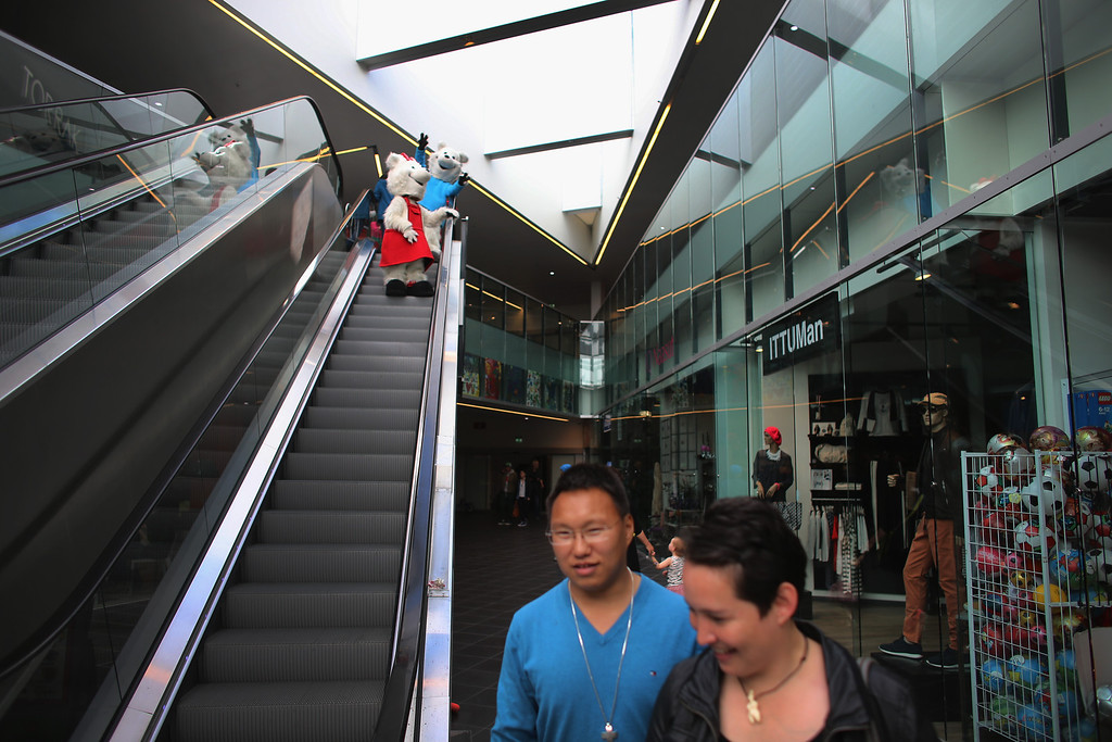 . People dressed as Polar Bears ride the escalator at Nuuk Center a mall that recently opened on July 28, 2013 in Nuuk, Greenland. (Photo by Joe Raedle/Getty Images)