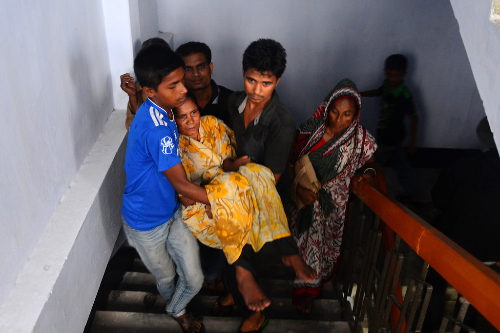 . Bangladeshi evacuees assist a paralysed relative as they evacuate to a shelter while Cyclone Mahasen heads towards landfall in Chittagong on May 15, 2013. Hundreds of thousands of people in Bangladesh and Myanmar were ordered to evacuate Wednesday as a cyclone bore down on coastal areas home to flood-prone refugee camps for victims of sectarian unrest.  MUNIR UZ ZAMAN/AFP/Getty Images