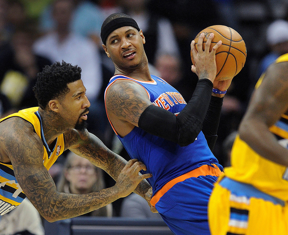 . New York forward Carmelo Anthony battled for position against Denver defender Wilson Chandler in the second half.   The Denver Nuggets defeated the New York Knicks 97-95 at the Pepsi Center Friday night, November 29, 2013.    Photo By Karl Gehring/The Denver Post