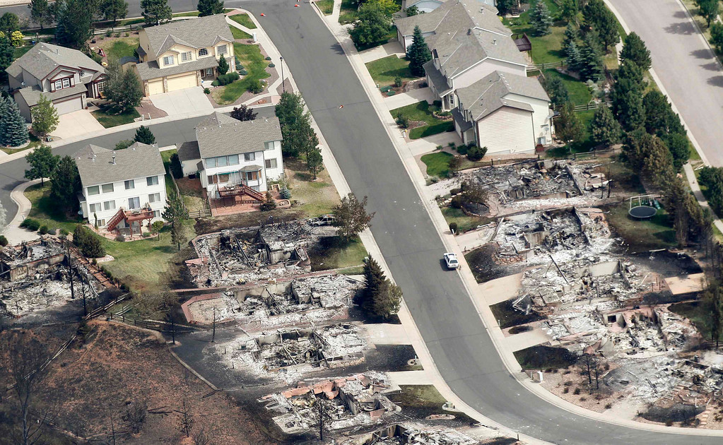 . Some of the hundreds of totally destroyed homes are seen in the aftermath of the Waldo Canyon fire in Colorado Springs, Colorado June 28, 2012.  Cooler temperatures and lighter winds helped firefighters on Thursday in the battle against the fire, which has destroyed hundreds of homes and forced more than 35,000 people to flee. REUTERS/Rick Wilking