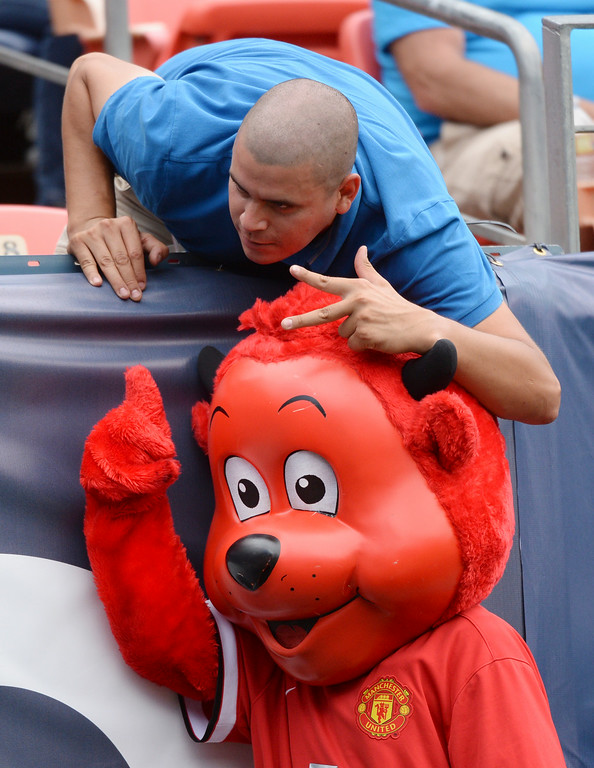. Manchester United mascot Fred the Red posed for a picture with a fan before the second half. Manchester United defeated AS Roma 3-2 in an exhibition soccer game at Sports Authority Field in Denver Saturday afternoon, July 27, 2014. Photo by Karl Gehring/The Denver Post