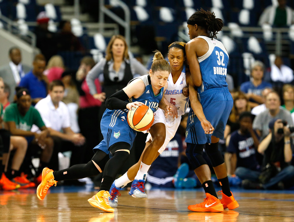 . ATLANTA, GA - OCTOBER 10:  Lindsay Whalen #13 of the Minnesota Lynx drives Jasmine Thomas #5 of the Atlanta Dream into a screen by Rebekkah Brunson #32 during Game Three of the 2013 WNBA Finals at Philips Arena on October 10, 2013 in Atlanta, Georgia.  (Photo by Kevin C. Cox/Getty Images)