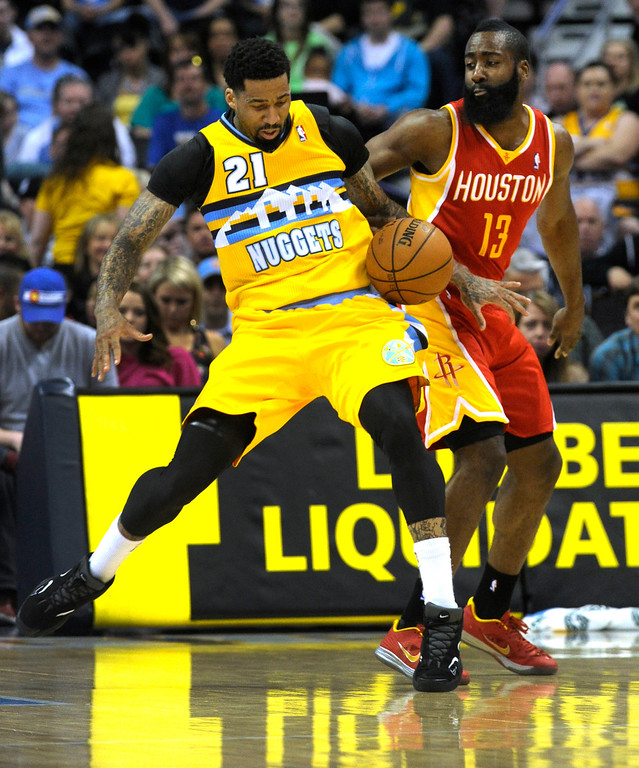 . DENVER, CO. - APRIL 6: James Harden (13) of the Houston Rockets harassed Wilson Chandler (21) of the Denver Nuggets in the first half. The Denver Nuggets hosted the Houston Rockets at the Pepsi Center Saturday night, April 6, 2013. Photo By Karl Gehring/The Denver Post)