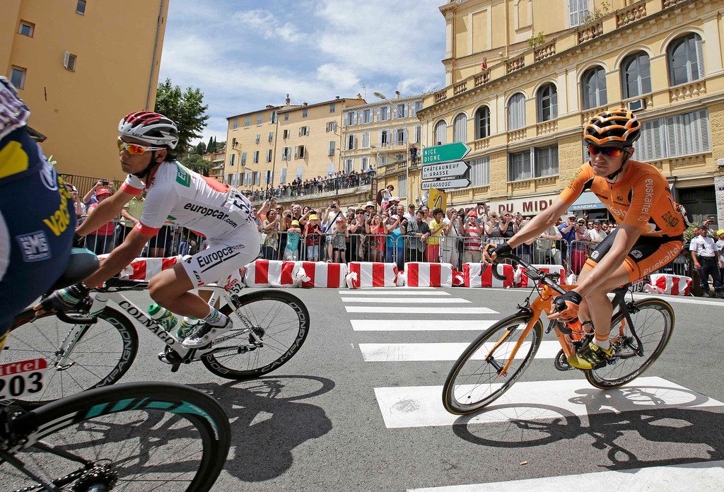 . Europcar team rider Yukiya Arashiro (L) of Japan and Euskatel-Euskadi team rider Romain Sicard (R) of Spain  cycle in Grasse during the 228.5 km fifth stage of the centenary Tour de France cycling race from Cagnes-Sur-Mer to Marseille July 3, 2013.     REUTERS/Jacky Naegelen
