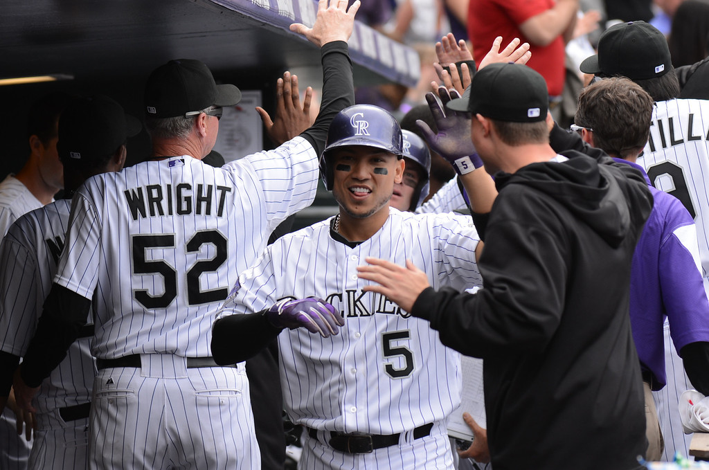 . Carlos Gonzalez (5) of the Colorado Rockies celebrates after scoring on a double by Troy Tulowitzki (2) of the Colorado Rockies in the third inning. (Photo by Hyoung Chang/The Denver Post)