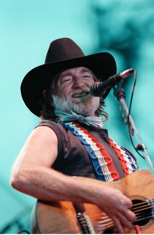 . Singer Willie Nelson performs at the Reebok Riverstage, new outdoor music center in New York, on July 12, 1989. (AP Photo/Mario Suriani)