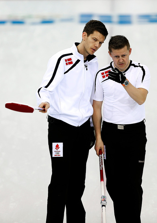 . Denmark\'s skip Rasmus Stjerne Hansen, left, and Johnny Frederiksen, right, discuss their next move during the men\'s curling competition against Canada at the 2014 Winter Olympics, Thursday, Feb. 13, 2014, in Sochi, Russia. (AP Photo/Wong Maye-E)