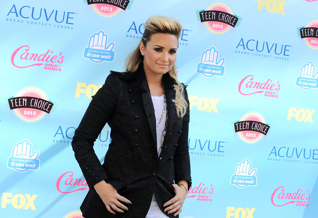 . Demi Lovato arrives at the Teen Choice Awards at the Gibson Amphitheater on Sunday, Aug. 11, 2013, in Los Angeles. (Photo by Jordan Strauss/Invision/AP)