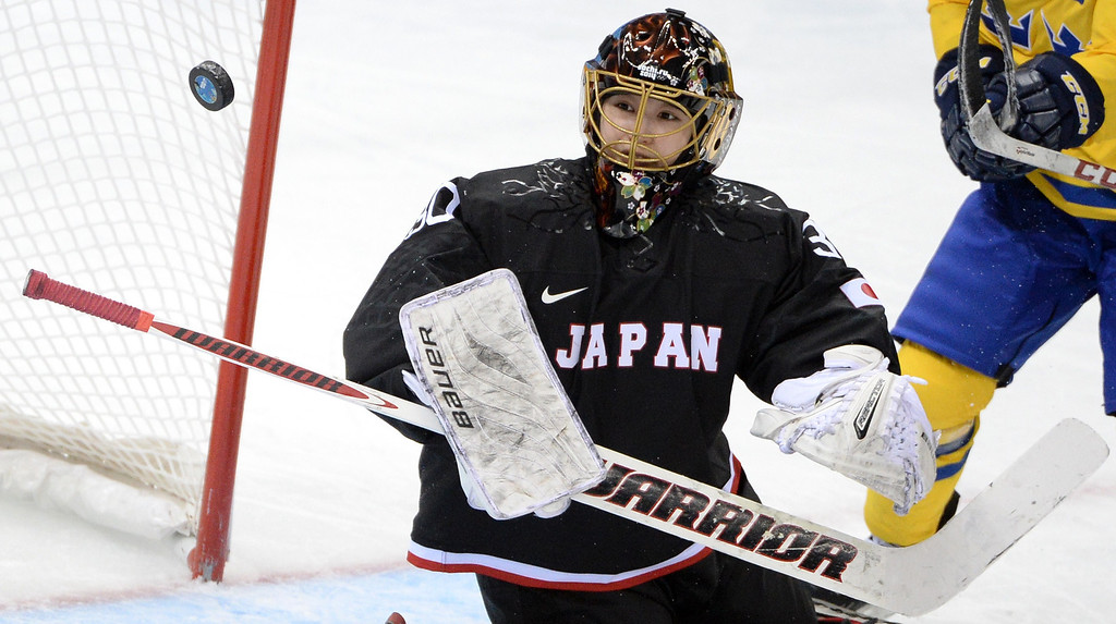 . Japan\'s goalkeeper Nana Fujimoto eyes the puck during the Women\'s Ice Hockey Group B match Sweden vs Japan at the Shayba Arena during the Sochi Winter Olympics on February 9, 2014. ANDREJ ISAKOVIC/AFP/Getty Images