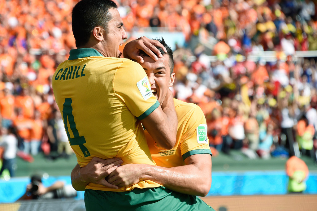 . Australia\'s forward Tim Cahill (L) celebrates with a teammate after scoring during a Group B football match between Australia and the Netherlands at the Beira-Rio Stadium in Porto Alegre during the 2014 FIFA World Cup on June 18, 2014. JUAN BARRETO/AFP/Getty Images