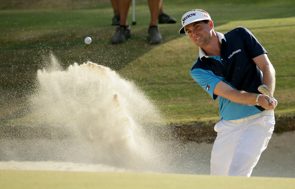 . Keegan Bradley hits out of the bunker on the 16th hole during the first round of the U.S. Open golf tournament in Pinehurst, N.C., Thursday, June 12, 2014. (AP Photo/Charlie Riedel)