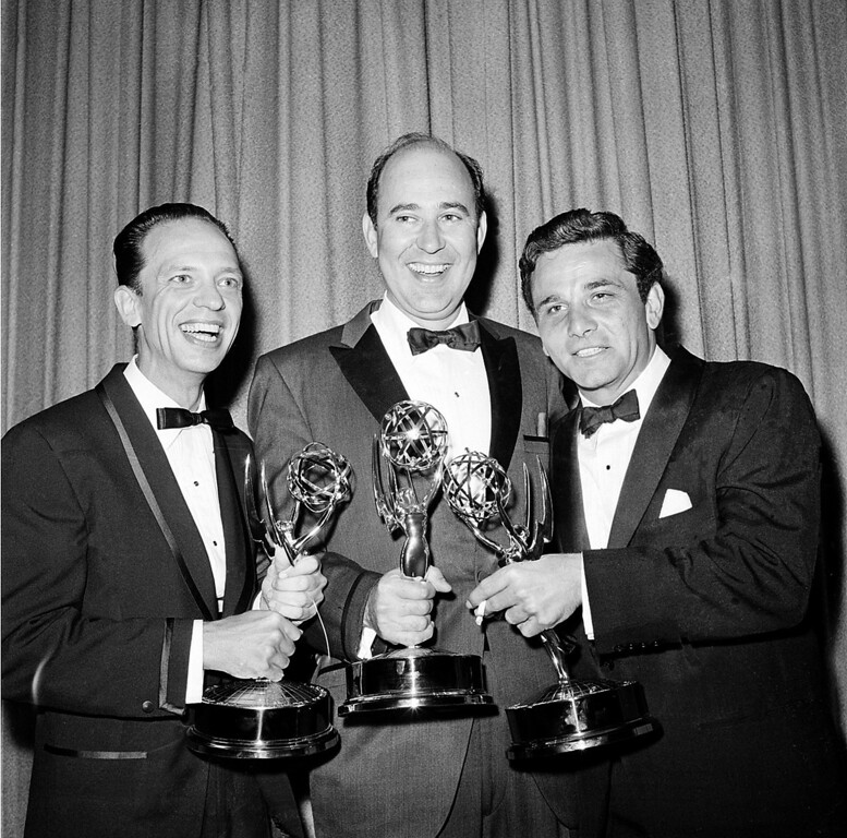 ". Writer Carl Reiner, center, poses with actors Don Knotts, left, and Peter Falk as they hold their statuettes at the Emmys Awards in Hollywood, Ca., May 22, 1962.  Knotts was named outstanding performance in a supporting role by an actor in ""The Andy Griffith Show\""; Reiner won outstanding writing achievement in comedy for the \""Dick Van Dyke Show\""; and Falk was named outstanding single performance by an actor in a leading role in \""The Dick Powell Show, The Price of Tomatoes.\""  (AP Photo)"