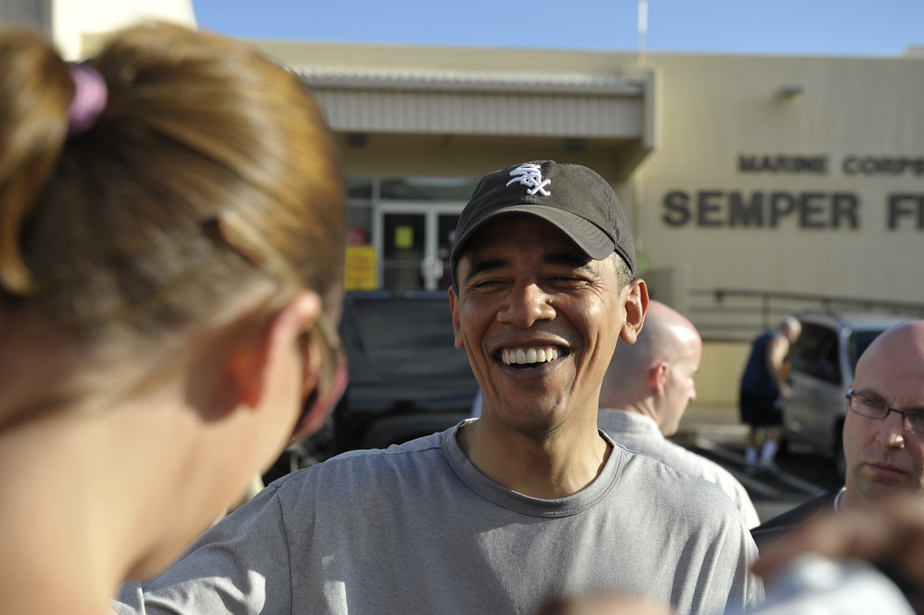 . U.S. President-elect Barack Obama greets well wishers after working out at the gym at Marine Corps Base Hawaii at Kaneohe Bay December 24, 2008 in Kailua, Hawaii. Obama and his family arrived in his native Hawaii December 20 with his family for the Christmas holiday.  (Photo by Joaquin Siopack-Pool/Getty Images)