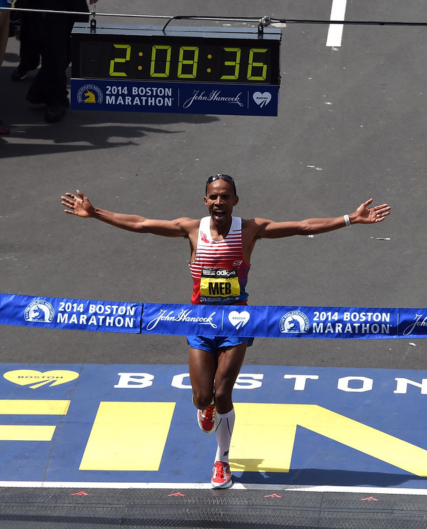 . Men\'s Elite division winner Meb Keflezighi of the US crosses the finish line during the 118th Boston Marathon in Boston, Massachusetts April 21, 2014 .  AFP PHOTO / Timothy A. CLARY/AFP/Getty Images