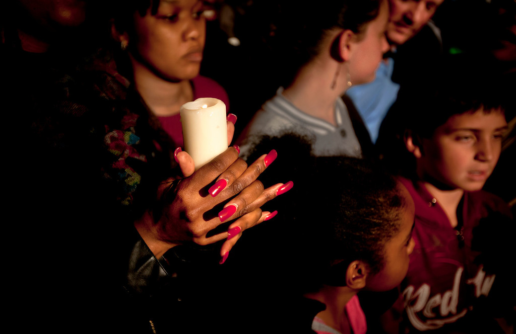 . A woman from a community group based in Pretoria holds a candle and sings religious songs to show appreciation and support for former South African President, Nelson Mandela, on the street outside the Mediclinic Heart Hospital where he is being treated in Pretoria, South Africa Tuesday, June 25, 2013. South Africa\'s president Jacob Zuma on Tuesday urged his compatriots to show their appreciation for Nelson Mandela, who is in critical condition in a hospital, by marking his 95th birthday next month with acts of goodness that honor the legacy of the anti-apartheid leader. (AP Photo/Ben Curtis)