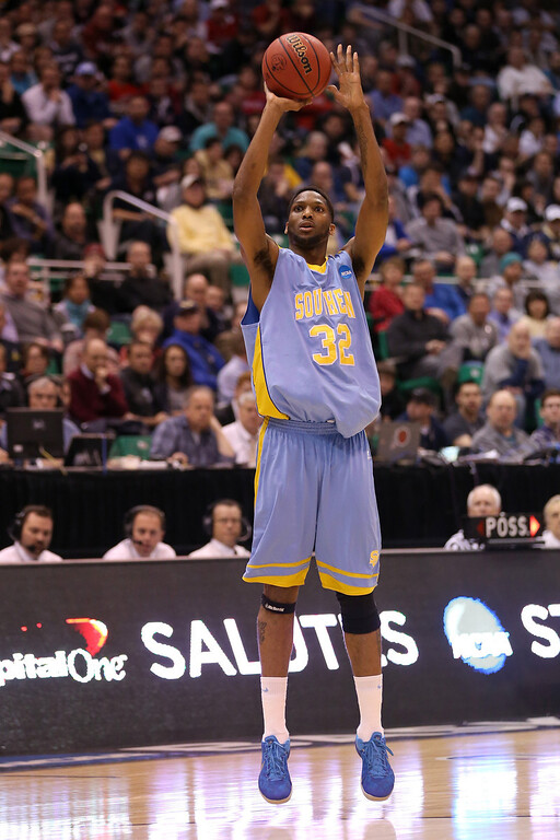. SALT LAKE CITY, UT - MARCH 21:  Brandon Moore #32 of the Southern University Jaguars shoots a three-pointer in the first half against the Gonzaga Bulldogs during the second round of the 2013 NCAA Men\'s Basketball Tournament at EnergySolutions Arena on March 21, 2013 in Salt Lake City, Utah.  (Photo by Streeter Lecka/Getty Images)