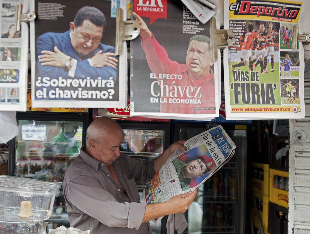 . A man reads a newspaper the day after the death of Venezuelan President Hugo Chavez, on March 6, 2013, in Cali, department of Valle del Cauca, Colombia. AFP PHOTO / LUIS  ROBAYO/AFP/Getty Images