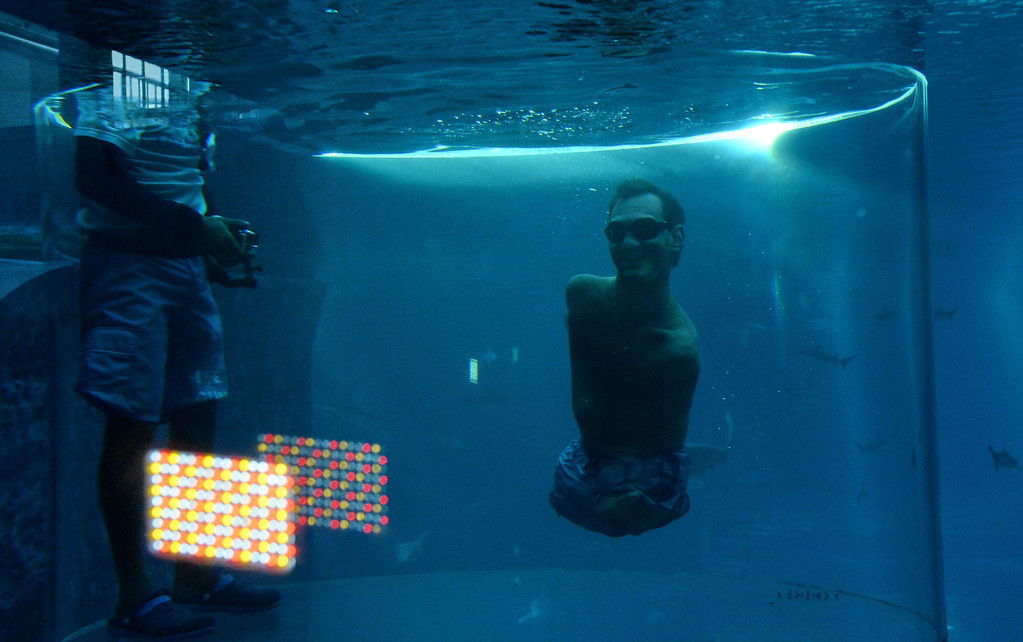 . Australian motivational speaker, Nick Vujicic, who was born without limbs, swims in a shark habitat while protected within a customised acrylic enclosure at Marine Life Park, Resort World Sentosa in Singapore on September 5, 2013. Vujicic is in Singapore for a one-day event where he will be speaking to a 5,000 strong audience. ROSLAN RAHMAN/AFP/Getty Images